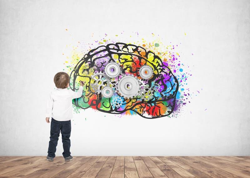 逗人喜爱的小男孩文字图画标志嵌齿轮脑子 图库摄影