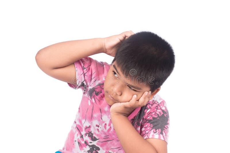 逗人喜爱的抓头的儿童亚裔小男孩 库存照片