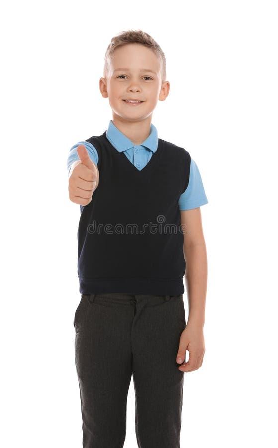 逗人喜爱的男孩画象校服的在白色 图库摄影