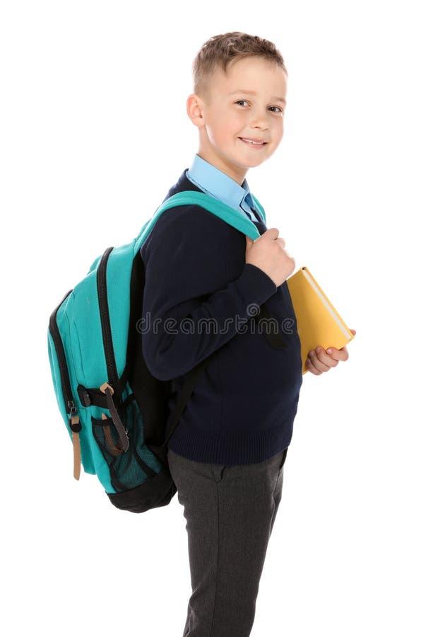 逗人喜爱的男孩画象校服的在白色 免版税库存照片