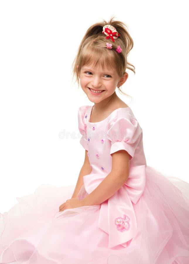 逗人喜爱的礼服女孩一点粉红色 库存照片