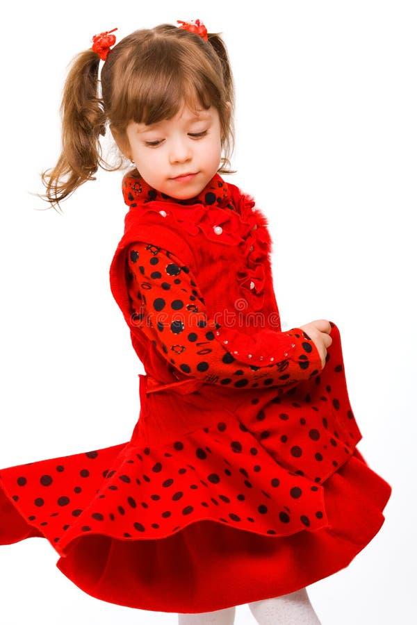 逗人喜爱的礼服女孩红色的一点 库存照片