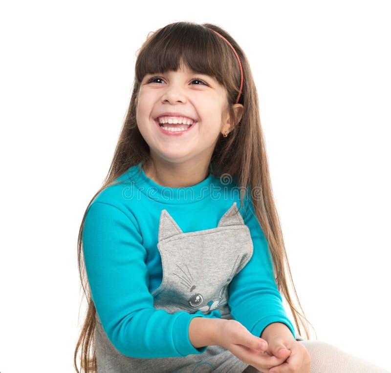 逗人喜爱的笑的小女孩纵向 免版税库存图片