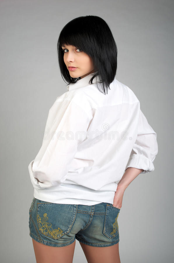 逗人喜爱的精神衬衣妇女年轻人 库存照片