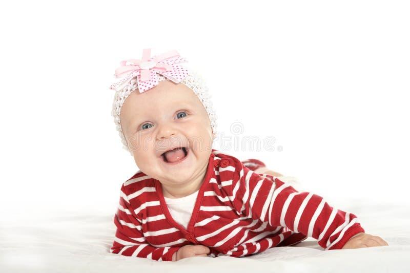 逗人喜爱的衣裳的女婴 免版税库存图片
