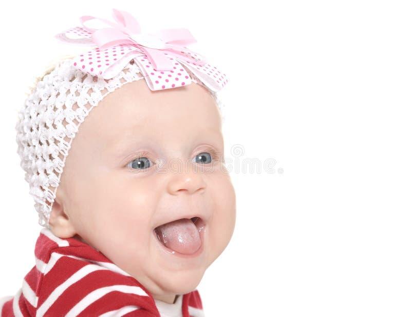 逗人喜爱的衣裳的女婴 免版税图库摄影