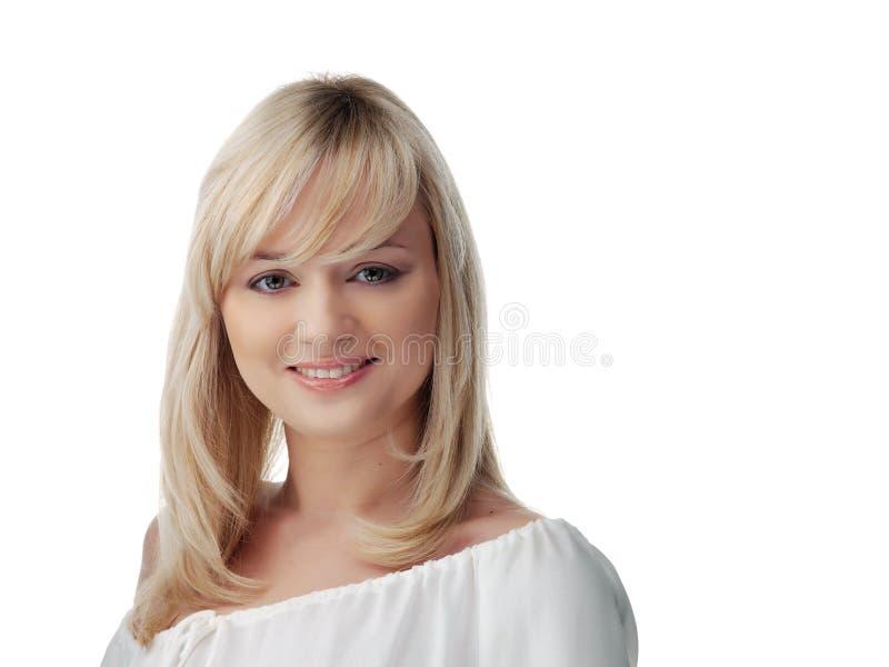 逗人喜爱的表面微笑的妇女 库存照片