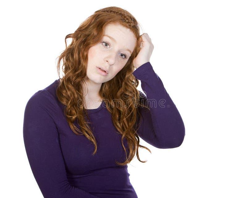 逗人喜爱的题头朝向她红色抓青少年 库存照片
