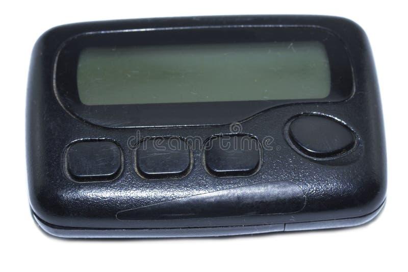 通信设备的葡萄酒小配件 在白色背景隔绝的黑老传呼器 库存图片