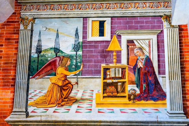 通告玛丽天使中世纪壁画教会圣吉米尼亚诺意大利 免版税图库摄影