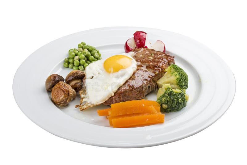 通常早餐牛排、鸡蛋和菜 图库摄影
