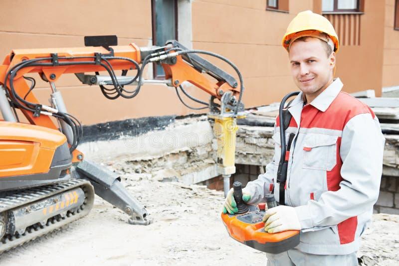 建造者工作者操作的爆破设备 库存图片