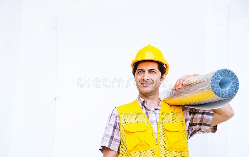 建造者运载在白色背景的绝缘材料卷 免版税库存图片
