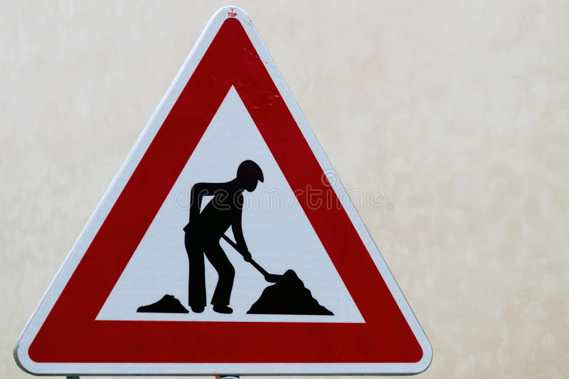 道路工程为在街道的建筑工作签字 库存照片