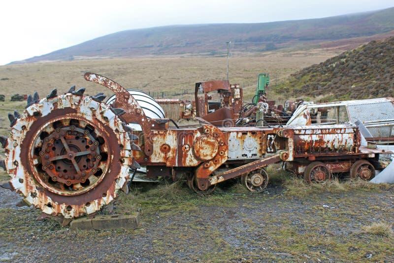 遗弃采掘机械 图库摄影