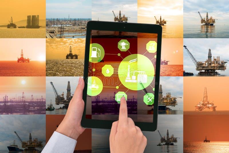 遥控操作概念的油工作者在石油工业 免版税库存图片