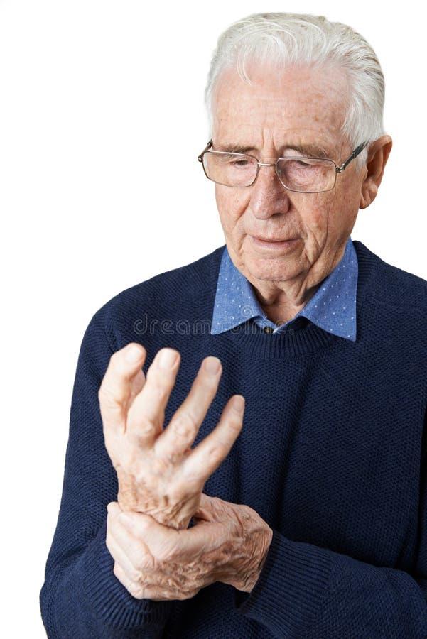 遭受与关节炎的老人 库存图片