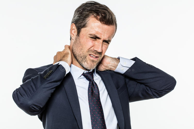 遭受公司痛苦的被拉紧的年轻有胡子的经理 库存照片