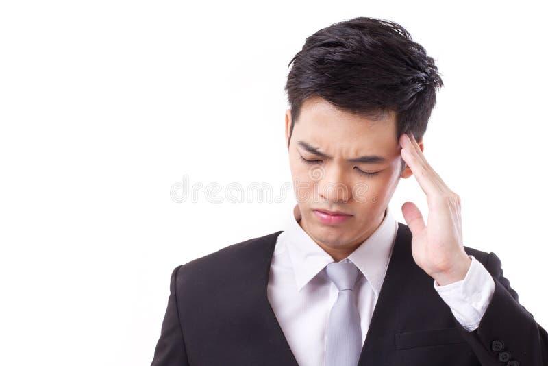 遭受头疼的病的亚洲商人 库存照片