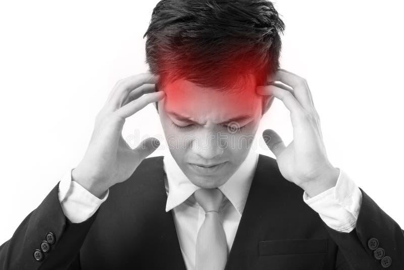 遭受头疼的病的亚洲商人 库存图片