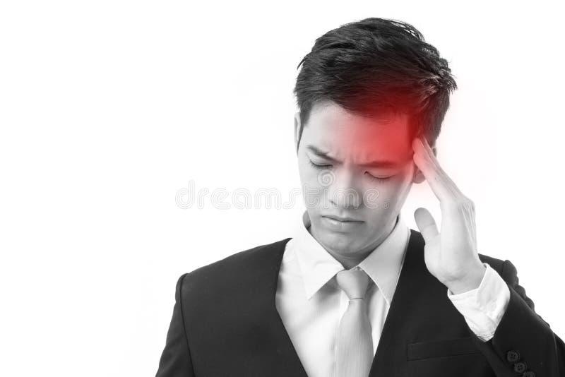 遭受头疼的病的亚洲商人 免版税库存图片