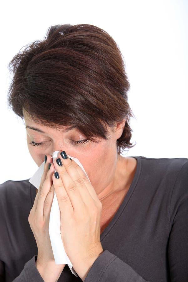 遭受寒冷和流感的妇女 免版税图库摄影