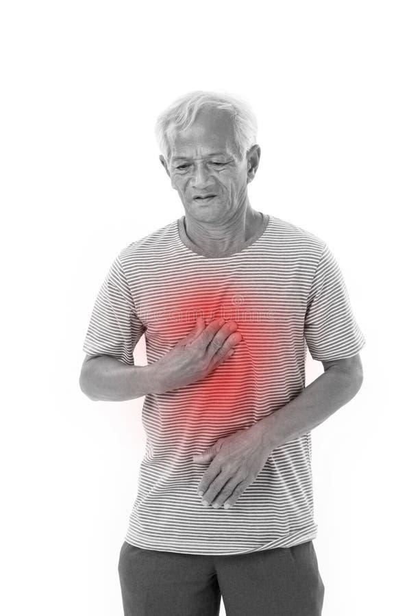 遭受胃灼热,酸倒回的病的老人 免版税库存图片