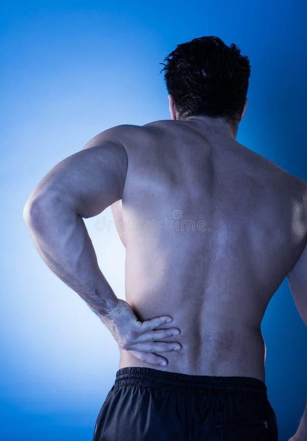 遭受背部疼痛的人 库存照片