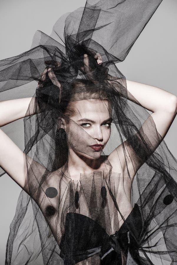 遮掩时尚妇女艺术时髦照片红色嘴唇 图库摄影