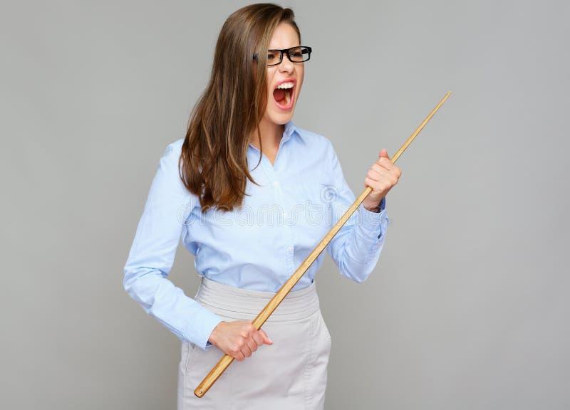 邪恶的妇女老师尖叫,拿着尖鞭子 图库摄影