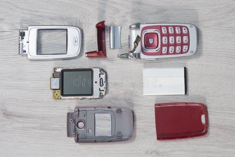 部分计划的手机在柜台说谎 库存图片