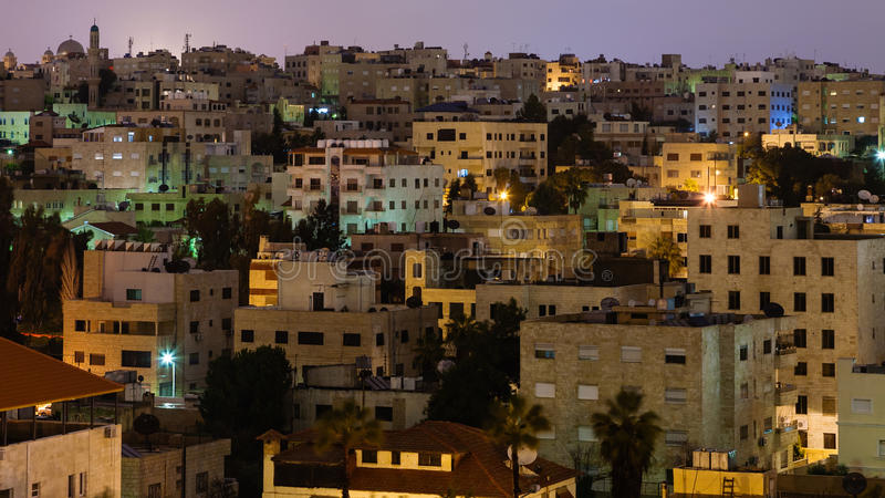 都市房子在阿曼市在夜 免版税库存图片