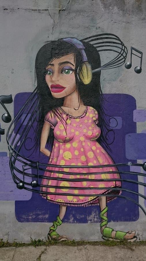 都市街道画-耳机音乐女孩画象 库存图片