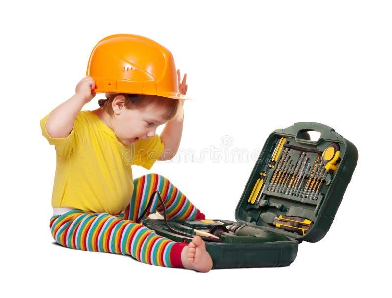 配件箱安全帽小孩工具 免版税库存图片