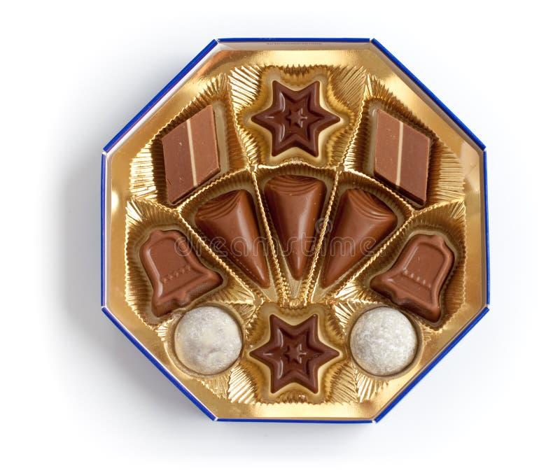 配件箱巧克力不同的形状糖果 库存照片