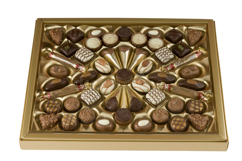 配件箱糖果在路径白色的巧克力剪报 免版税库存照片