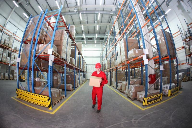 配件箱红色统一大商店工作者 免版税库存图片