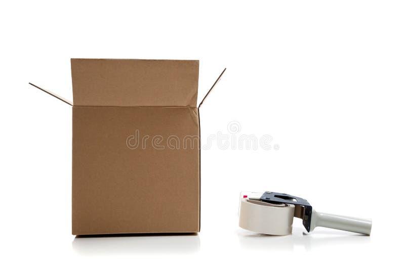 配件箱纸板枪发运磁带 免版税库存照片