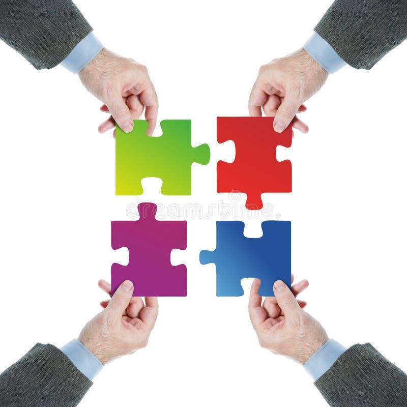 配合 一个队的被协调的工作往一个共同目标的 免版税库存照片