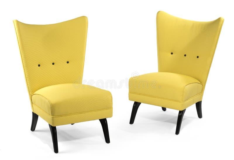 配对在白色隔绝的明亮的黄色软的椅子 免版税库存照片
