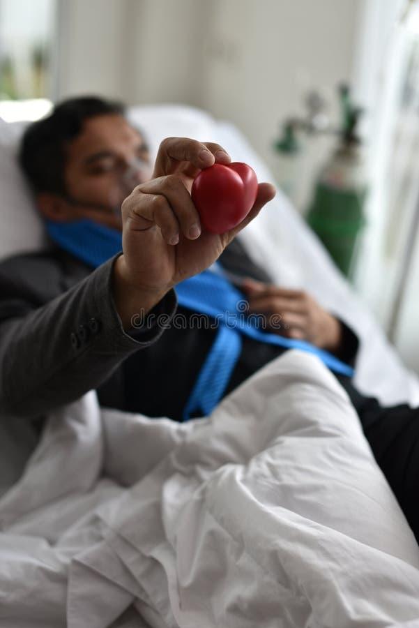 酒客在床上甚而睡觉在医院 库存图片