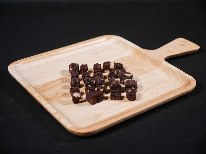 酥脆嘎吱咬嚼的皮包骨头的巧克力杏仁果仁巧克力 免版税库存图片