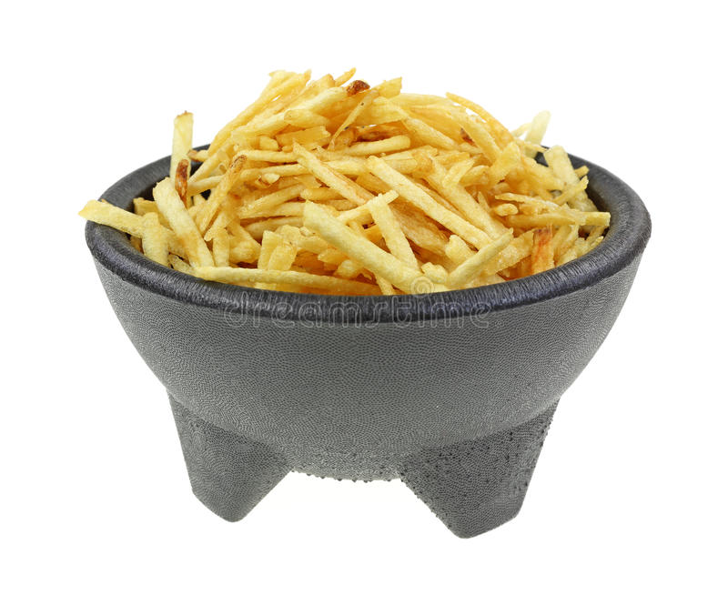 酥脆土豆黏附黑垫座碗 免版税库存图片