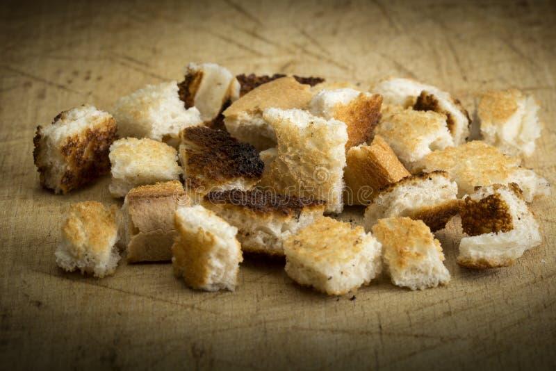 酥脆油煎方型小面包片 库存图片