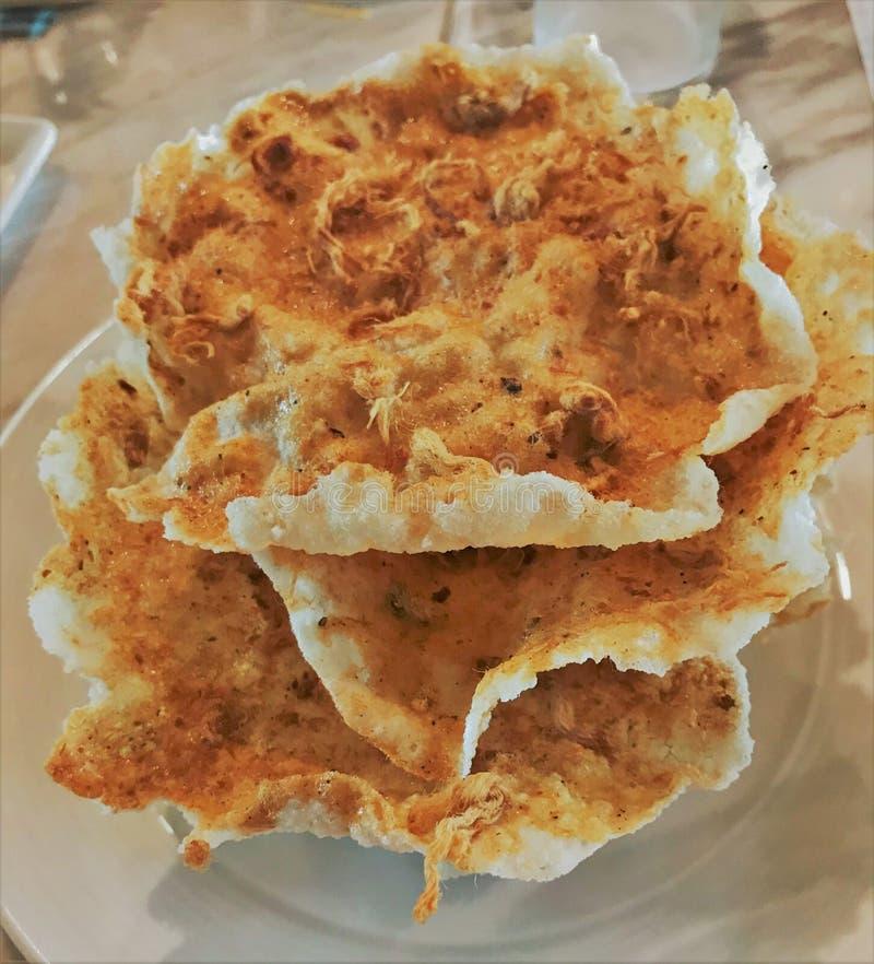 酥脆米绉纱用干切细的猪肉 库存照片