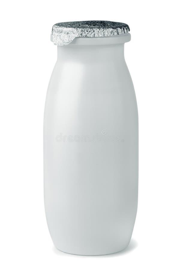 酸奶瓶 免版税库存图片