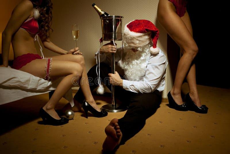 醉了的克劳斯通过了圣诞老人 库存照片