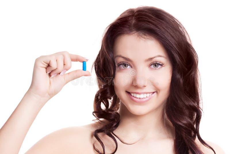 采取妇女的药片 免版税库存图片