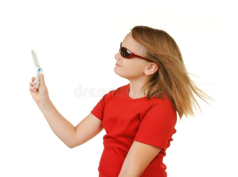 采取年轻人的女孩电话 图库摄影
