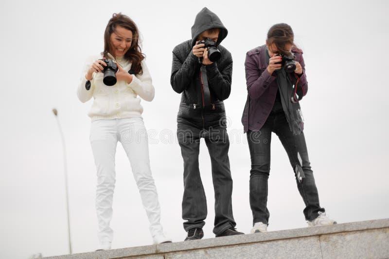 采取捕获的无固定职业的摄影师 图库摄影